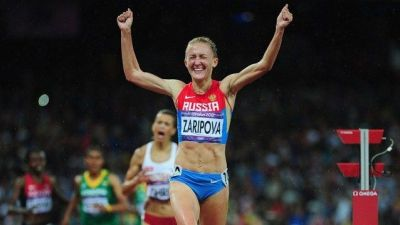 1366278420_Yuliya-Zaripova-of-Russia-celebrates-as-she-crosses-the-finish-line-to-win-the-gold