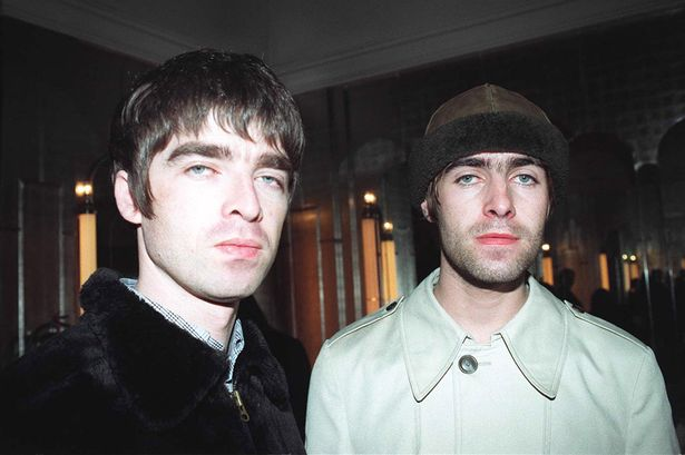 Noel and Liam Gallagher of Oasis at the 1995 Q Magazine Music Awards in London