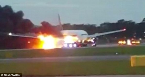 35b4e16f00000578-3661493-a_singapore_airlines_plane_has_caught_fire_pictured_on_the_runwa-m-7_14670052710041